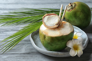 Fresh green coconut on wooden table