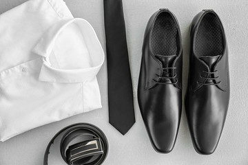 Composition with elegant male shoes and accessories on light background
