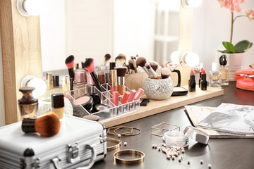 Table with cosmetics in modern makeup room