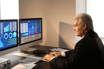Male broker working in office. Finance trading concept
