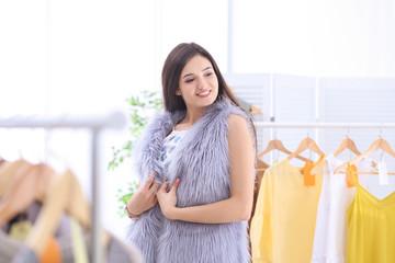Young beautiful woman shopping in store