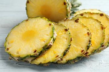Fresh sliced pineapple on table, closeup
