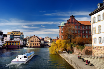 Petite France historic area of Strasbourg old town with canals in spring or autumn sunny day
