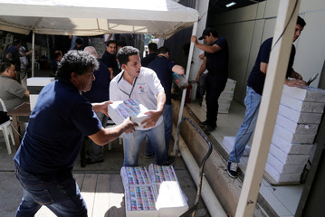 Electoral workers transport materials for the upcoming presidential election at the Superior Court of Electoral Justice in Asuncion
