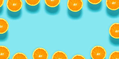 Fresh orange halves on a blue background