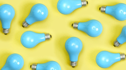 Wall Mural - Blue painted lightbulbs on a yellow background