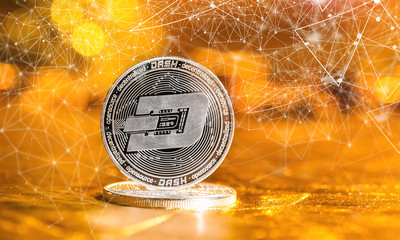 Dash cryptocurrency coin on a golden background