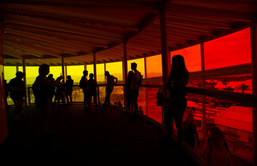 "Concertgoers stand inside an installation called ""Spectra"" at the Coachella Valley Music and Arts Festival in Indio"