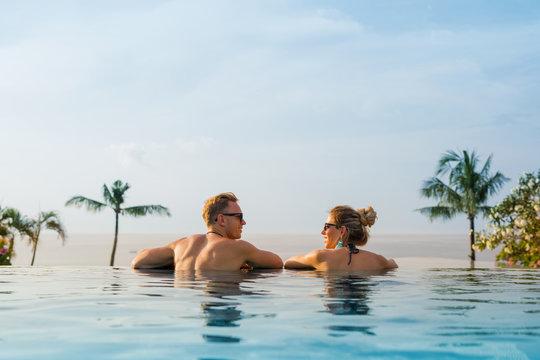 Happy couple in infinity pool