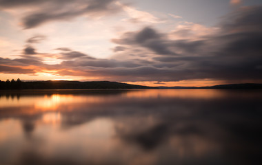 Beautiful sunset over a swedish natural lake photographed with long exposure