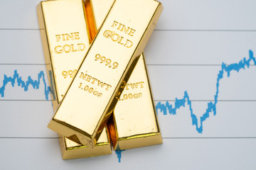 Gold bar, bullion stack on rising price graph as financial crisis or war safe haven, financial asset, investment and wealth concept