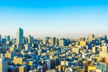 Asia business concept for real estate and corporate construction - panoramic urban city skyline aerial view under twilight sky and golden sun in hamamatsucho, tokyo, Japan