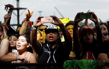 Concertgoers watch a performance by Cardi B at the Coachella Valley Music and Arts Festival in Indio
