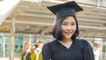 asian teen girl with graduation gown cloth with feeling happy