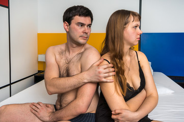 Couple having conflict in bed at home - family quarrel concept