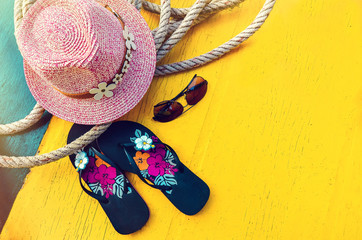 Set of Woman's Things Accessories to Beach Season Straw Beach Woman's Hat Yellow Background Flat Single. Copy space
