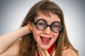 Funny nerd or geek woman with sexual expression on face