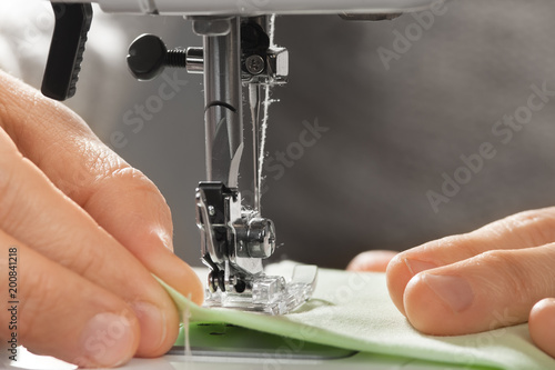 Hands Of Woman Working On The Sewing Machine Stock Photo And Delectable Hands Free Sewing Machine