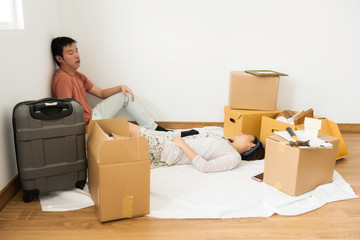 Tired couple sleep at new moving house
