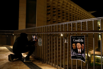 Activists from pressure group #occupyjustice hang posters attacking Prime Minister Joseph Muscat outside Parliament House as Maltese mark six months since the assassination of anti-corruption journalist Daphne Caruana Galizia, in Valletta