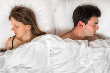 Young couple sleeping together in bed