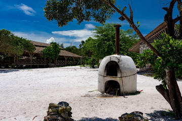 White old bread oven made of clay standing on the beach at sunny day. Koh Rong Samloem, Cambodia.