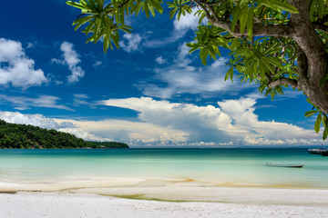 Tropical beach with turquoise clean water,  blue sky and white sand. Saracen Bay, Koh Rong Samloem. Cambodia, Asia.