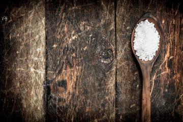 Salt in a wooden spoon.