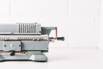 Old calculating machine on white background. Accounting or business concept