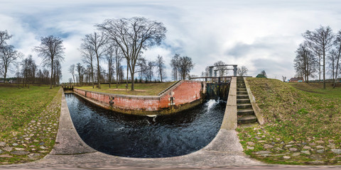 panorama 360 angle view near gateway lock construction on river, canal for passing vessels at different water levels. Full spherical 360 degrees seamless panorama in equirectangular projection