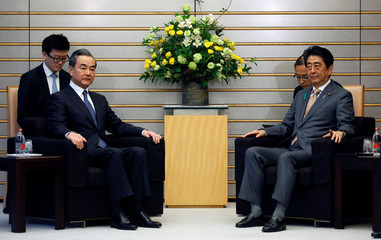 Chinese government's top diplomat, State Councillor Wang meets with Japan's PM Abe at Abe's official residence in Tokyo
