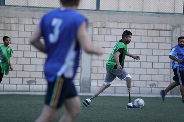 Hussain Al Howicom, a Saudi born with congenital amputation, plays soccer in Dammam