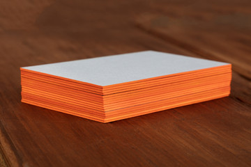 Stack of blank layered business cards with painted edges