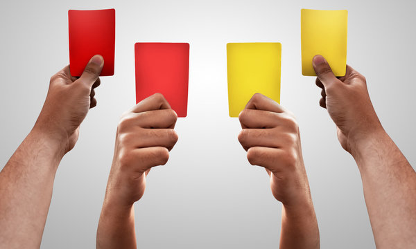 Set of hands holding red and yellow card