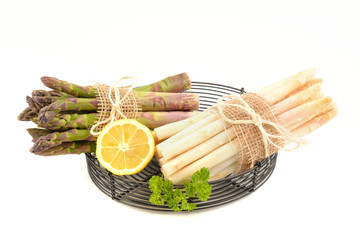 Fresh green and white asparagus on white background.