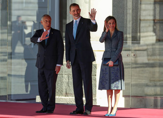 Portugal's President Marcelo Rebelo de Sousa waves with Spain's King Felipe and Queen Letizia during a ceremony at the Royal Palace in Madrid