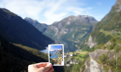 View of the Geiranger fjord and playing card, beautiful norwegian nature, sunny day, Norway