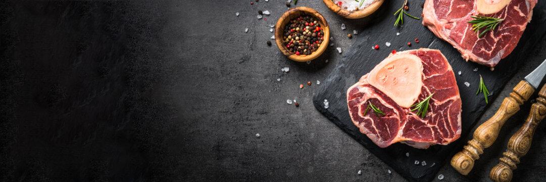 Raw beef steak osso bucco on black. Marble meat.