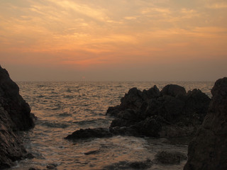 Sunset view over sea with stones