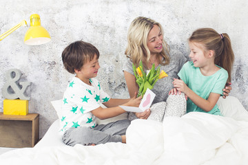 Happy Family - Children congratulate their mom on Mother's Day