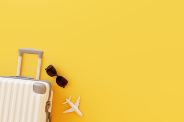 Flat lay white suitcase with sunglasses and plane on yellow background. 3D rendering. travel concept