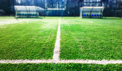 Dramatic marking line on football field background
