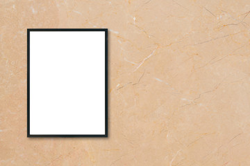 Mock up blank poster picture frame hanging on brown marble wall background in room - can be used mockup for montage products display and design key visual layout.
