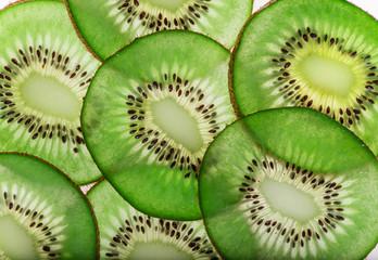 Bright fresh kiwi slices, back light transparent fruit.