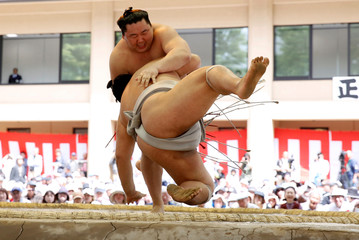Sumo wrestlers compete during an annual sumo tournament dedicated to the Yasukuni Shrine in Tokyo