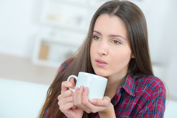 beautiful young girl resting with a cup of coffe
