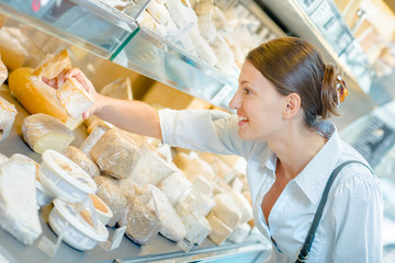 Lady choosing cheese