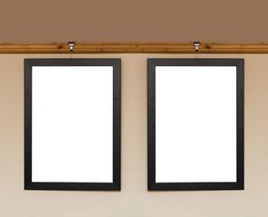 Blank photo frame hanging on a dado rail in a living room