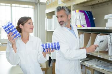 scientists talking in lab