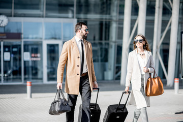 Business couple leaving the airport